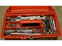 Mechanics Toolbox with various spanners, sockets and wrenches.