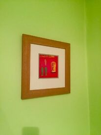 colourful mounted and framed picture