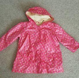 Girls raincoat age 12-18 months.