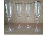 Four champagne flutes