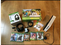 Xbox One S bundle with controller, gaming headset, stand, battery packs and games.