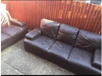 Brown leather sofas with matching tables and foot stool can be delivered