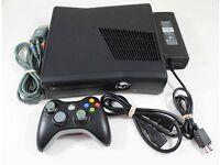 XBOX 360 Elite + 2 Controllers.