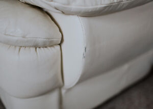 Cream leather loveseat - great condition