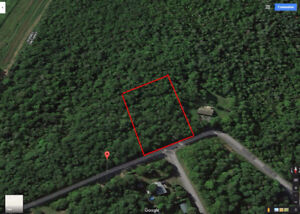 Gorgeous 1 acre lot located near Quebec/Ontario  border