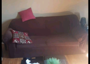 Green pullout couch with brown cover