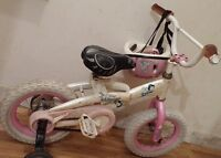 Girl's bike with learning wheels, Helmet and knee pads