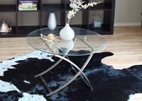 Stylish round glass table with silver legs