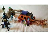 Playmobil stagecoach with cowboys, rocks and bandit