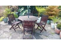 Teak Round Garden Table & Four Chairs (parasol not included)
