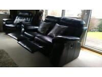 Black leather electric reclining sofas - two 2 seaters and a chair armchair suite recliner