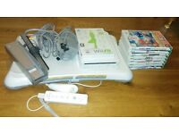 Nintnedo Wii Bundle 9 Games Wii Fit Board All Leads and 1 official controller
