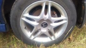 set of four Honda 4 stud 16 inch alloy wheels with good tyres