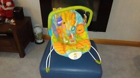 Bouncy seat with hanging toys.