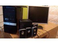 Computer Desktop, monitor, logitech sound system