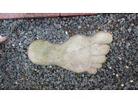 Giant's concrete feet stepping stones
