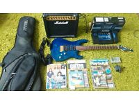 Guitar + Case + Amp + effects processor + More.