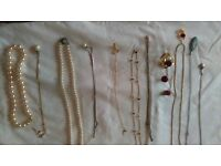 A variety of Neclaces with one matching earings and broach