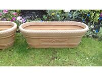 Two lovely large hard plastic planters in VGC 60cms x 20 cms and 5 wall hanging baskets various