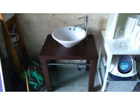 free standing washhand basin within solid wood table