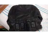 black leather motorcycle jacket and trousers