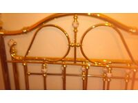 4ft 6in metal frame bed , shaped head and straight foot, with ornate finials. Buyer collectso