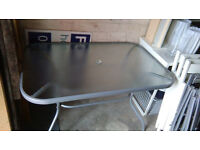 glass garden table and six ikea black folding chairs