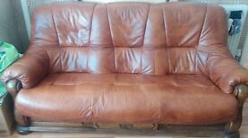 2 Leather sofas with solid oak base and one drawer