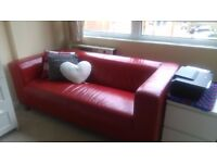 Large leather red sofa