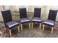 Four leather effect dining room chairs