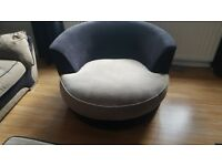 Taupe and black swivel chair and footstool