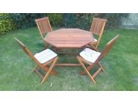 Wooden Garden Table and Four Chairs, including cushions.