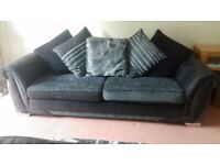 Great fabric/faux leather sofa, will fit four people,from DFS and very good condition.