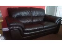 Dark Brown 2 seater leather sofa in excellent condition.