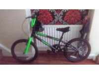 Boys black and green bmx bike , rarely used and in great condition.