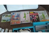 Nintendo Wii with games and wii fit board.