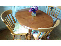 Oval pine kitchen table and four chairs.