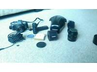 Pentax film camera with lenses and accessories