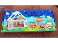 ELC Dolls House in very good clean used condition with 5 room sets and doll family in original box
