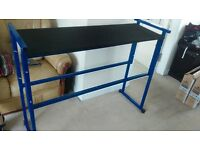 DJ stand with carpeted shelf and black front cloth.