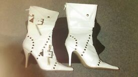 Brand new, white studded boots
