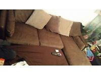 brown suede corner sofa with poffet