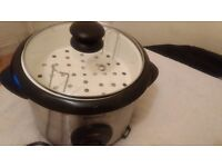 partly used Breville rice cooker with steamer tray