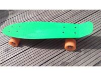 Retro Green Skateboard with Orange wheels. Good used condition, been taken outside once
