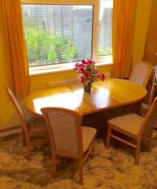 Teak expanding dining table and 4 chairs