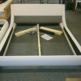 A brand new stylish white leatherette double bed frame.