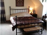 Attractive KING SIZE BED frame and bedsteads. Black metal. Can deliver Inverness.