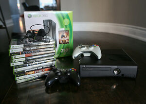 Xbox 360 (250GB) w/ 2 controllers, 12 Games, and accessories.