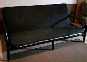 Metal futon with wood reinforcement