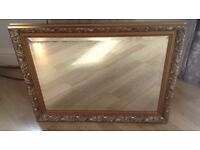 Large Mirror with Gold Border Decoration